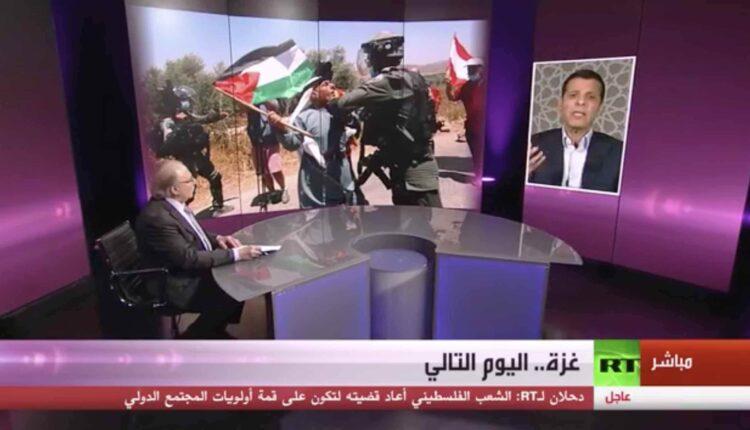 محمد دحلان في مقابلة عبر الاقمار الاصطناعية على قناة روسيا اليوم 24 مايو 2021 (الصورة- Screen Grab)